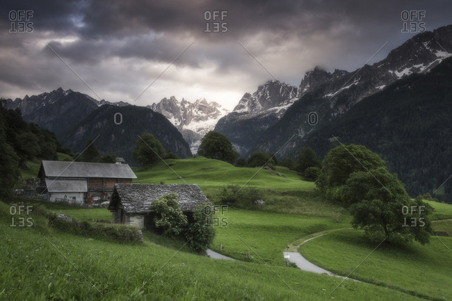 Clouds at dawn, Soglio, Bregaglia Valley, Maloja Region, Canton of Graubunden (Grisons), Switzerland, Europe