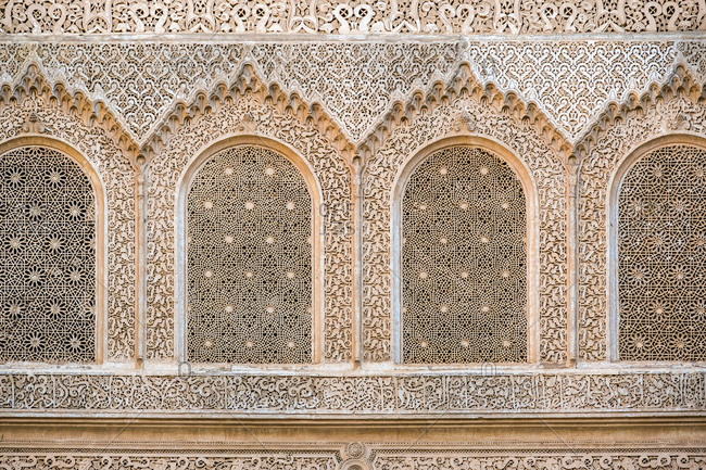 December 13, 2016: Carved plaster wall, Ben Youssef Madrasa, 16th century Islamic College, UNESCO World Heritage Site, Marrakesh, Morocco, North Africa, Africa