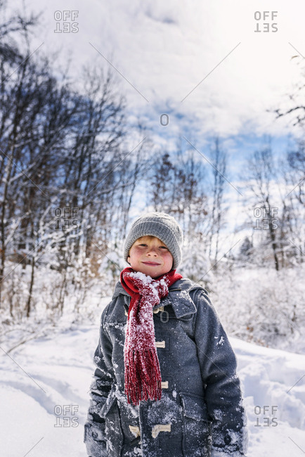 Portrait of a young boy outside in the winter