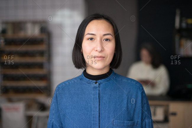 Portrait of young Asian woman in a grocery store