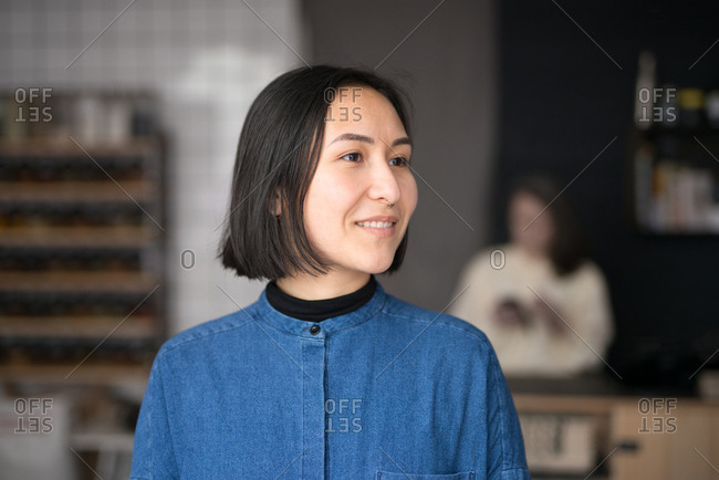 Young Asian woman in a grocery store looking away