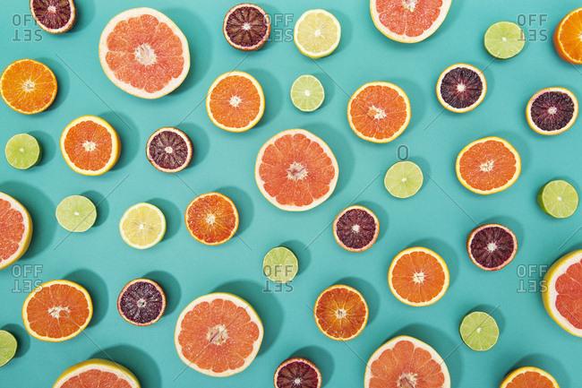 Multicolor citrus slices randomly spread over colorful background