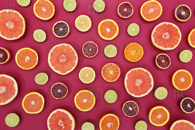 Product shot of alternating exposed citrus slices arranged on vibrant table