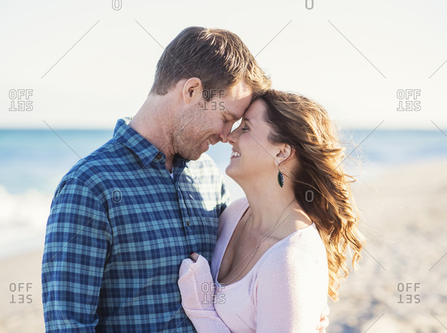 Happy couple in beach, face to face