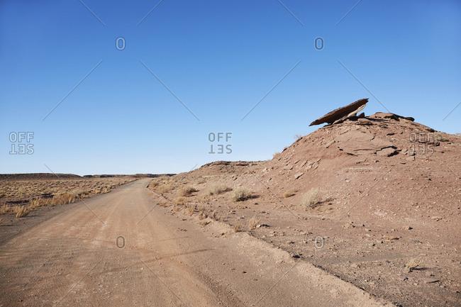 USA, Arizona, Empty road through desert landscape