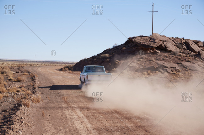 USA, Arizona, Pick up truck on dusty road