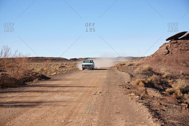 USA, Arizona, Pick up truck on dusty road