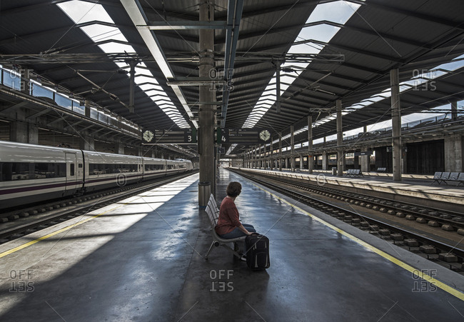 Spain, Andalusia, Cordoba, Woman on empty train platform