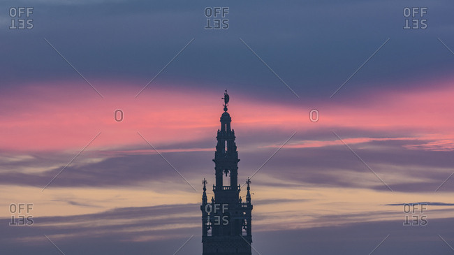 Spain, Andalusia, Seville, Bell tower of La Giralda against romantic sky