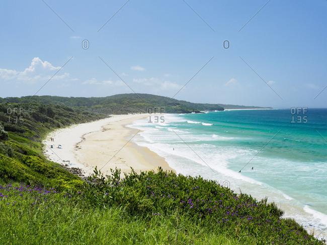 Australia, New South Wales, Moruya, Blue sky above coastline and sea