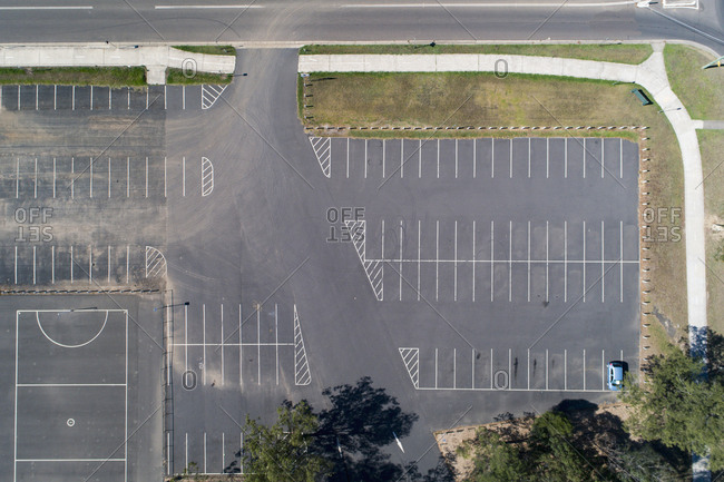 Parking lot next to playing field