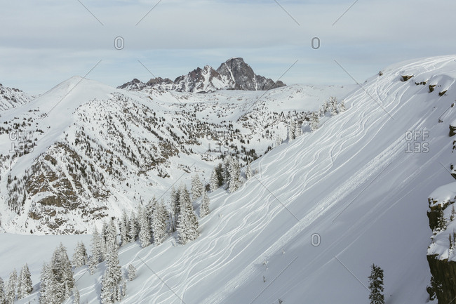 Scenic view of ski slope against snowcapped mountains