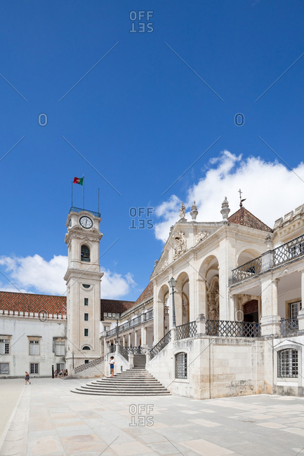 Coimbra, Portugal - 30 July, 2017: Courtyard and clock tower of the old Royal Palace and current University of Coimbra