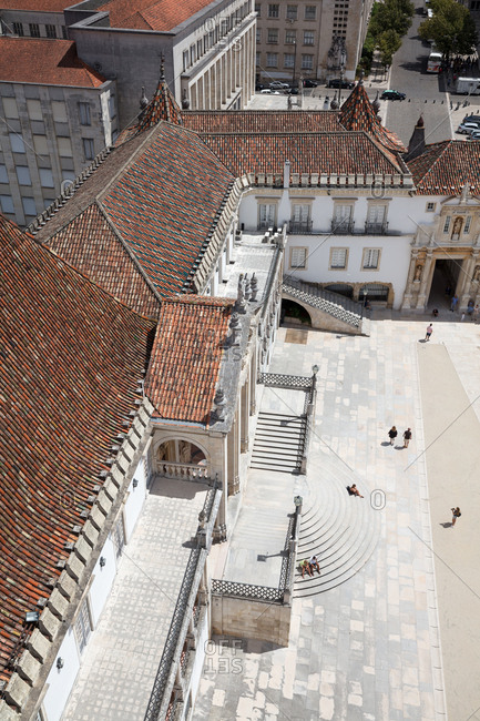 Coimbra, Portugal - 30 July, 2017: Looking down on entrance steps and courtyard from the bell tower of the former Royal Palace and current University of Coimbra