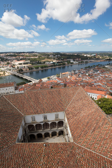 High angle view of River Mondego over the rooftops of the University of Coimbra and part of the city
