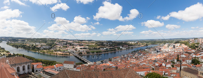 Elevated view of Mondego River over rooftops from bell tower of University of Coimbra