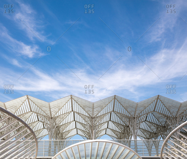Looking up at the airy lattice work roof of the Gare do Oriente station in Lisbon, Portugal