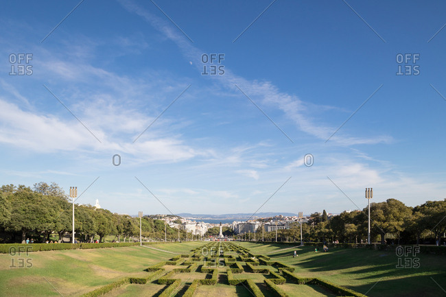 Lisbon, Portugal - 01 August, 2017: Looking down the sloping formal gardens of Edward VII Park towards the river Tagus
