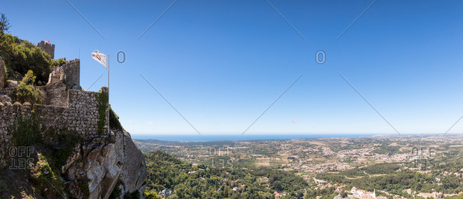 Sintra, Portugal - 02 August, 2017: Panoramic view of The Castle of the Moors on hilltop overlooking landscape towards the sea