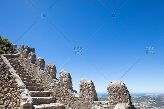 Looking up steep rocky stairs along defensive wall of Castle of the Moors in Sintra, Portugal
