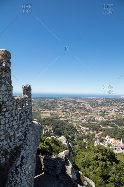 View of the sea from battlements of hilltop Castle of the Moors in Sintra, Portugal