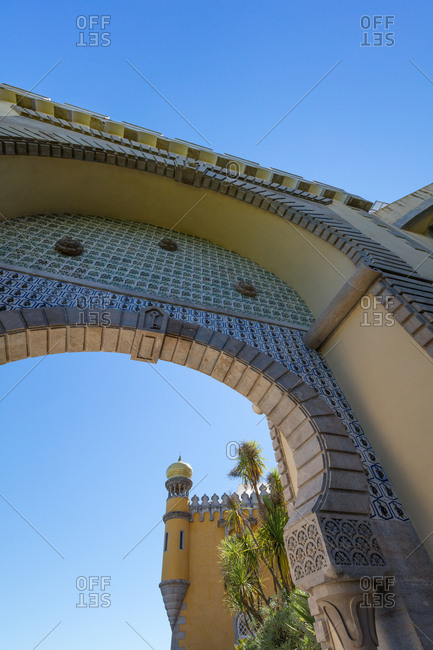 Low angle view of Moorish arch and decorative tiles at Pena Palace in Sintra, Portugal