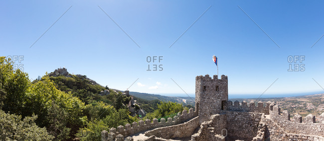 Panoramic view of defensive wall of Castle of the Moors overlooking lowlands towards the sea