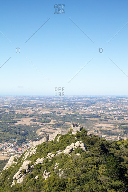 Elevated view of Castle of the Moors perched on rocky hilltop and landscape beyond