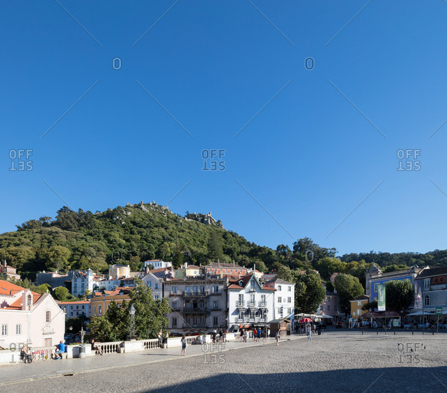 Sintra, Portugal - 02 August, 2017: The Castle of the Moors looking down on tourists roaming the town square
