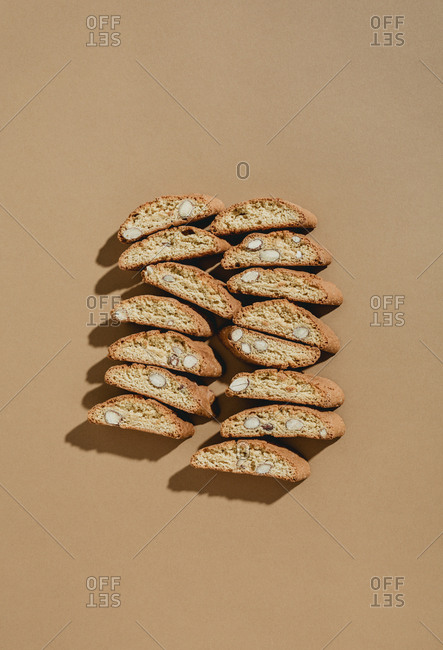 Top down view of two rows of almond biscotti laid out on background