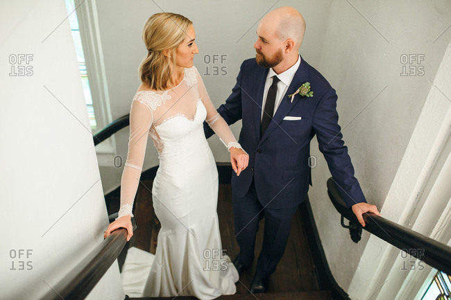 Loving newlywed couple pausing on stairs