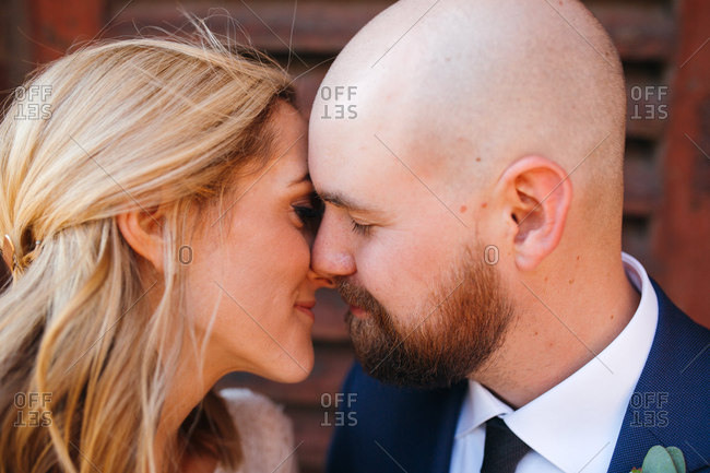 Bride and groom close-up before kiss outside