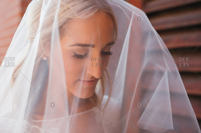 Close-up portrait of bride looking thoughtful in wedding veil