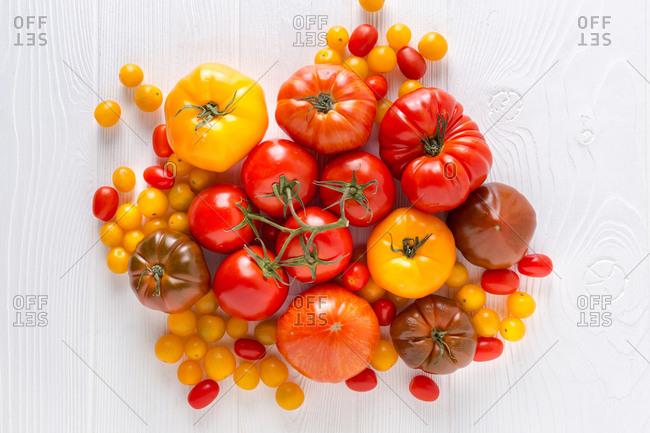 Variety of tomatoes on white background