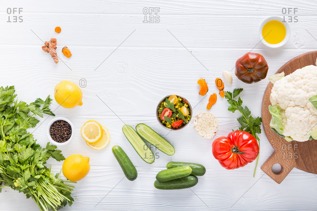 Variety of vegetables and lemon on white background