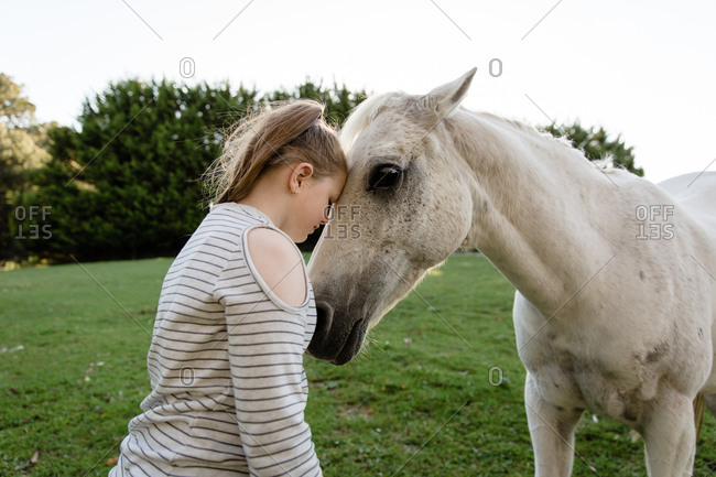 Girl connecting with horse
