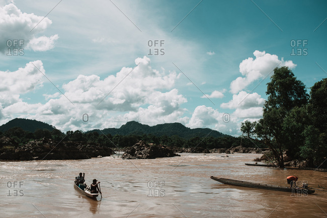 Rural Province, Laos - March 16, 2018: People driving canoe