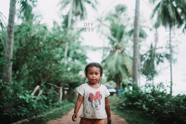 Bangkok, Thailand - March 16, 2018: Asian girl posing on nature