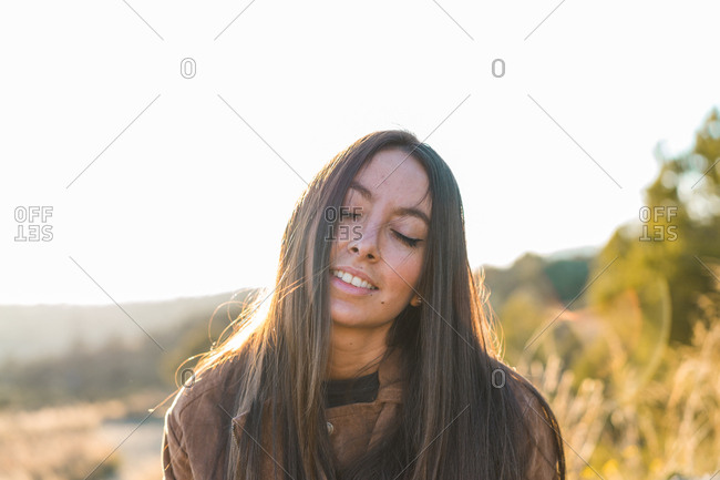 Cheerful woman posing in nature