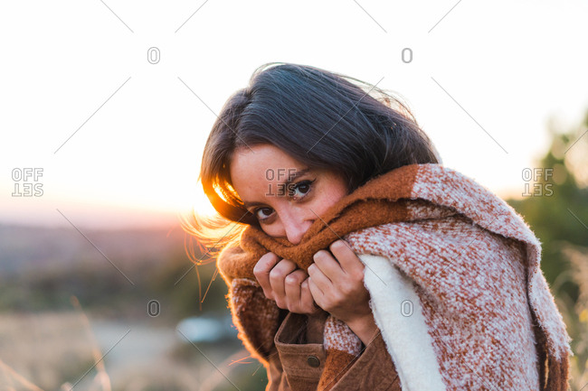 Young woman in scarf in nature