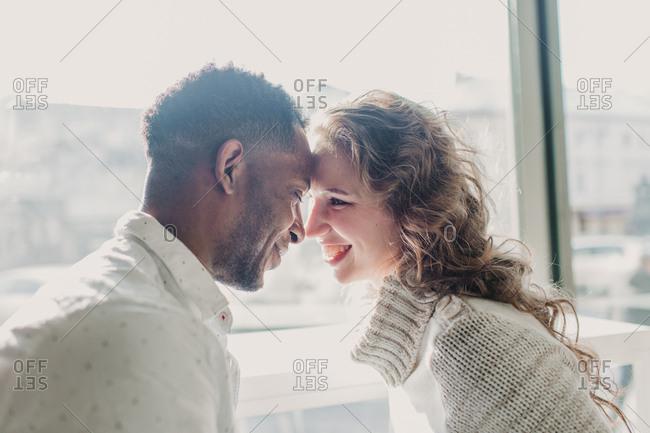 Couple in sweaters bonding