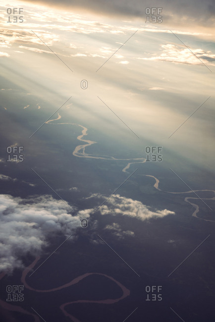 Aerial view to beautiful clouds and the ground in sunset lights.