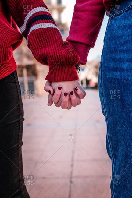 Teen hands together