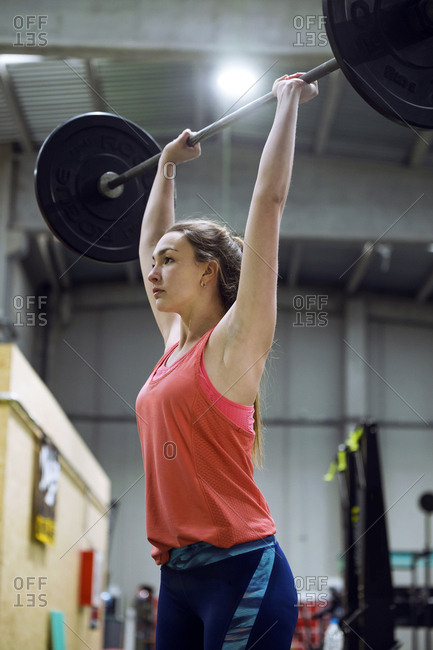 Pretty fit woman with barbell