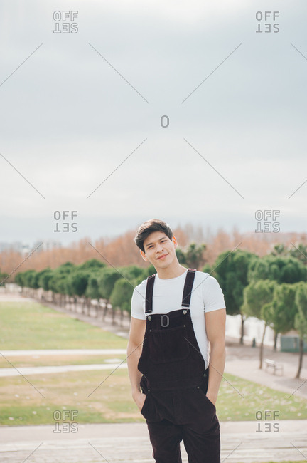 Handsome young boy strolling in the park