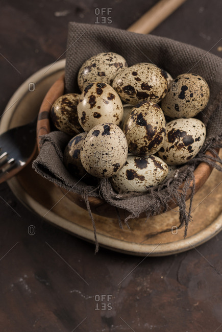 Several eggs of quail in a wooden Bowl. Gourmet food, ready to be cooked.