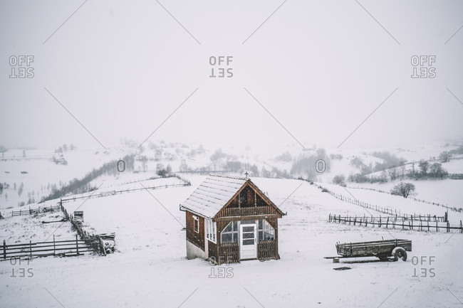 Lonely cabin in mountain and snow.