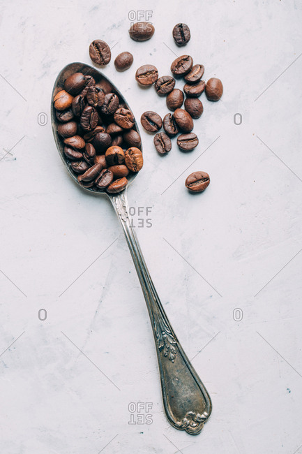 Coffee beans in retro spoons