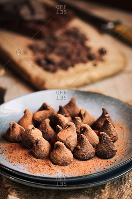 Chocolate truffles in a rustic plate
