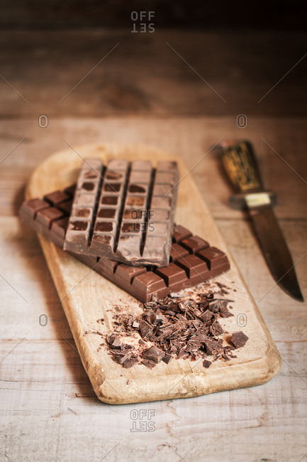 Chocolate chips on wooden cutting board